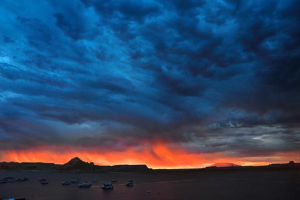 Sunrise on Lake Powell from Wahweap Marina. Rain clouds provide the fireworks.